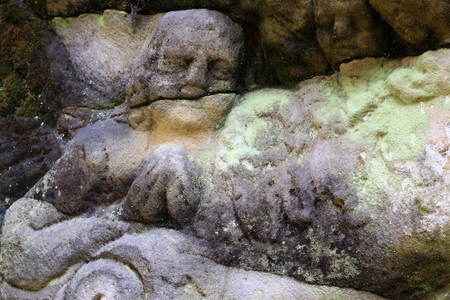 praying angel: Detail of the head of a praying angel in old stone altar