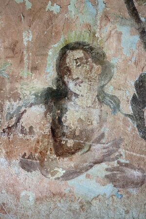 harmed: Old mural painting in the ruins of the church