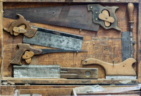 crosscut: Detail of the set of various hand saws Stock Photo