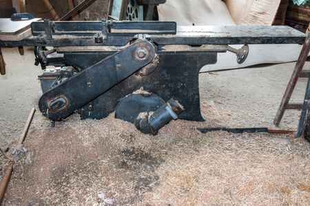 joinery: Old and used planing machine in the joinery workshop Stock Photo