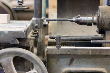 Old hole cuttern in the carpentry workshop Stock Photo