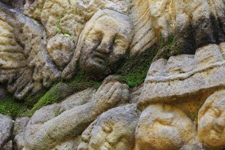 praying angel: Stone altar carved into the sandstone - detail of the head of a praying angel