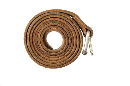 waistband: Coiled leather belt on a white background - tighten the belt