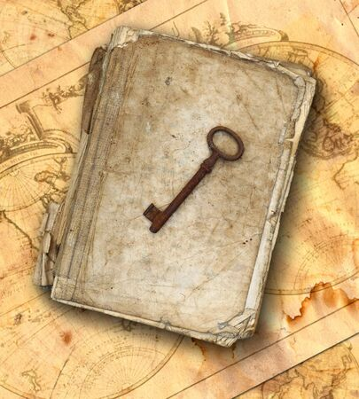 chronicle: Worn and tattered book and old rusty key on the old maps