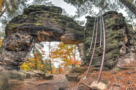Little Pravcice Gate is a natural sandstone arch, that is about 2.3 m high and 3.3 m wide. It is located in Bohemian Switzerland near the red signposted main hiking route - E3 European long distance path - between Mezni Louka village and Vysoka Lipa villa