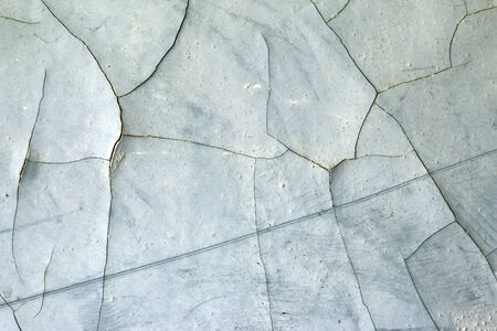 cranny: Detail of the cracked plaster - grunge texture - design flaw Stock Photo