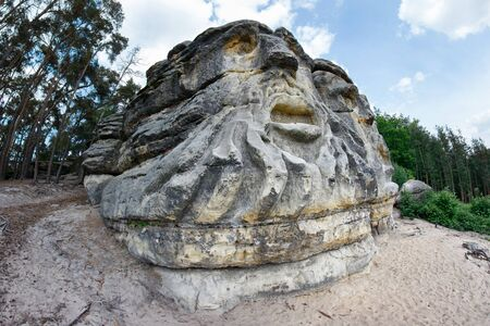 gruesome: Heads of Devils - rock sculptures of giant heads Stock Photo