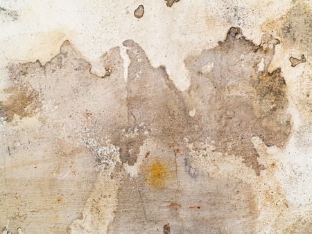 weatherworn: Dirty stains and cracks on the plaster - detail Stock Photo