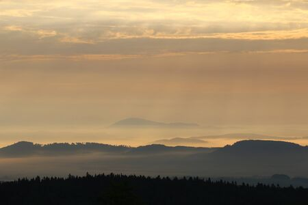 Sunrise in the mountains - hills in morning mist, Krkonose Stock Photo