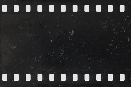 Strip of old celluloid film with dust and scratches - negative Stockfoto