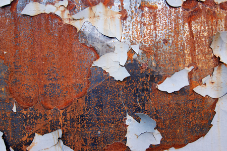 Rusty iron surface with peeling paint - grunge texture Stock Photo
