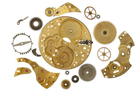 Clockwork-Mechanismus - verschiedener Teil des Uhrwerkmechanismus auf weißem Hintergrund