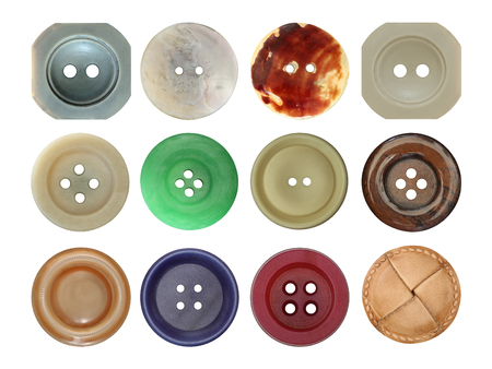 Various old and used buttons on white background