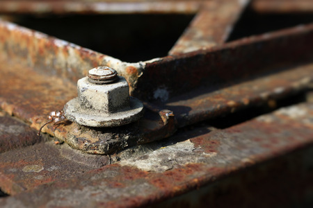 Detail of the old rusty bolted joint on the iron structure