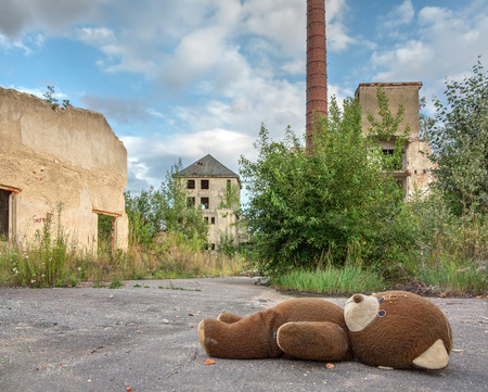 Abandoned and dilapidated factory overgrown of vegetation Stock Photo