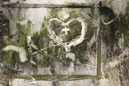 Shape of hearts - symbol of love - scribbled on a very dirty surface