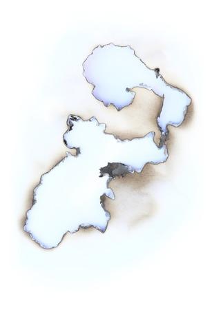 Détail du trou traversant brûlé dans un papier vierge
