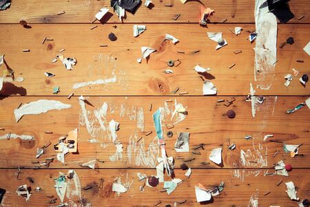 Old notice board with scraps of papers - abstract detail Stock Photo