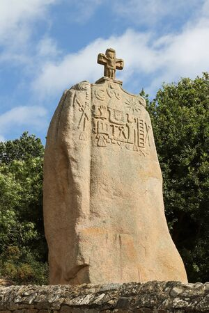 Menhir of Saint-Uzec. Menhir is about eight meters high and three meters wide. It is the largest menhir in France with Christian symbols. Pleumeur-Bodou, Brittany, France. 写真素材