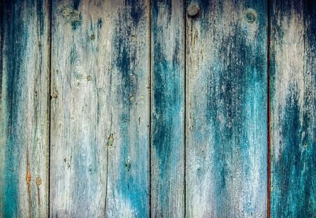 Old faded paint on wooden boards - wooden pattern useful like vintage background
