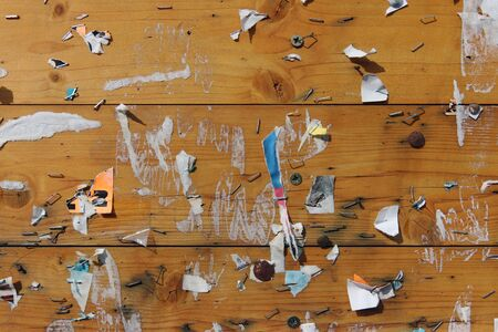Old notice board with scraps of paper - abstract detail Stock Photo