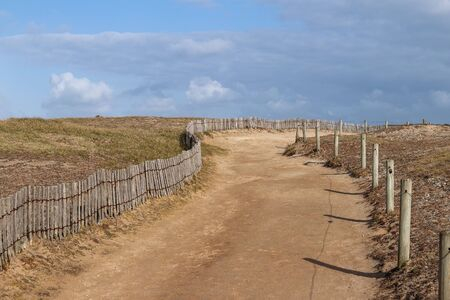 Sandy road along the coast of the peninsula Quiberon, Brittany, France 版權商用圖片