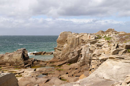 Cliffs on the coast of the Ile Grande - Big Island - in Pleumeur-Bodou in Brittany, France