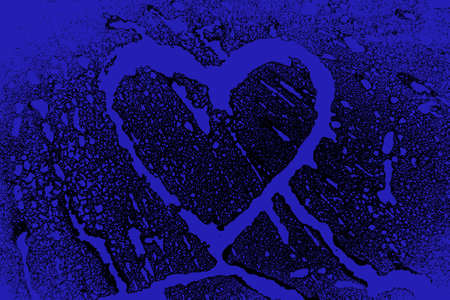 Abstract image of the Splashes of color forming heart in blue