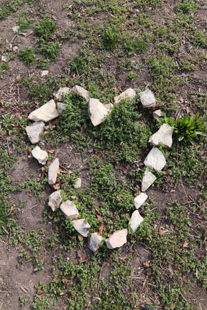 Heart shape from stones on the ground