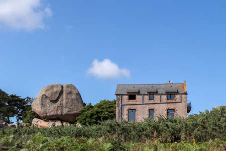 Ploumanach, France, August 7, 2019: Bouders on Pink Granite Coast - great natural site of Ploumanach, Brittany, France