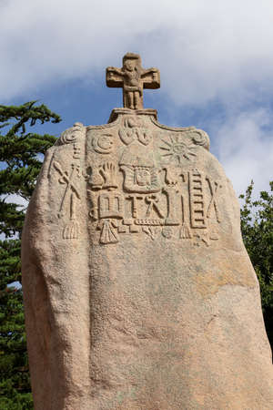 Pleumeur-Bodou, France, August 9,2019: Menhir of Saint-Uzec. Menhir is about eight meters high and three meters wide. It is the largest menhir in France with Christian symbols. Pleumeur-Bodou, Brittany, France. Editorial