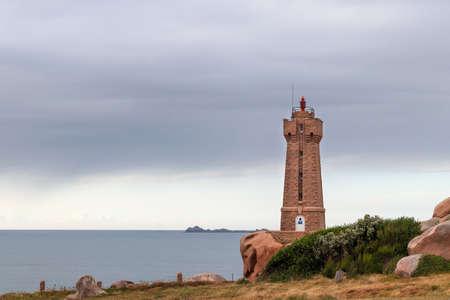 Ploumanach, France, August 7, 2019: Ploumanach Lighthouse - Mean Ruz Lighthouse - active lighthouse in Perros-Guirec, Cotes-d'Armor, Brittany, France