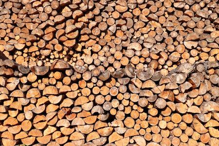 Large pile of logs - firewood - reserves of fuel Standard-Bild