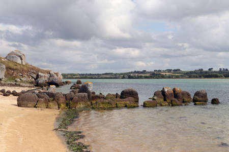 Neolithic tomb - dolmen or gallery grave also passage grave - of Guinirvit, ruins in the sea, Bay of Kernic, Plouescat, Finistere, Brittany, France Standard-Bild