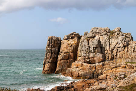 Rocky cliffs on the Pink Granite Coast - Cote de Granit Rose - near Le Gouffre in Brittany, Cotes d´Armor, France
