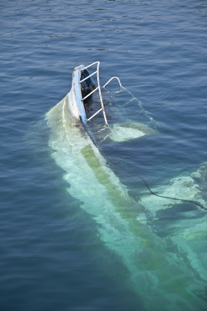 tsunamis: Wreck of a boat with the bow that rises from the water