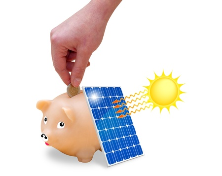 clean energy: Woman s hand putting money saved in a piggy bank