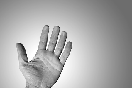 Wrinkled hand of a man working on a gradient background