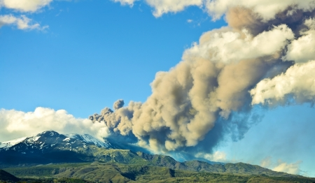Erupting volcano emits a large amount of smoke Stock Photo