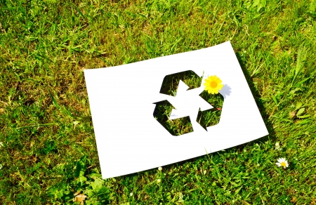 public waste: Cut paper with the logo of recycling Stock Photo