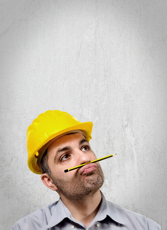 void: Engineer with a helmet on his head, reflecting staring into the void holding a pencil under her nose