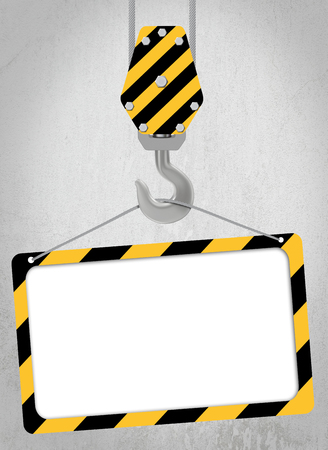 cartel: black and yellow crane hook hung with large steel cables Stock Photo