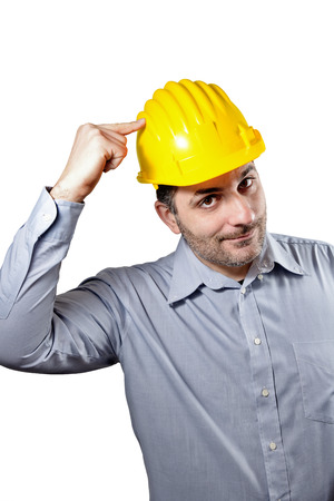 Engineer pointing with hand safety helmet holding on his head. Concept of safety in the workplace Stock Photo