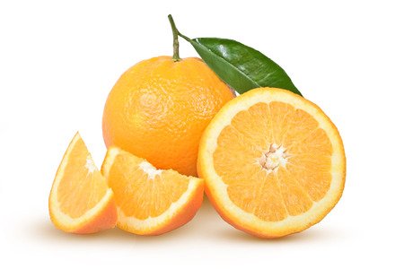 ripe oranges with a green leaf on a white background Stock Photo