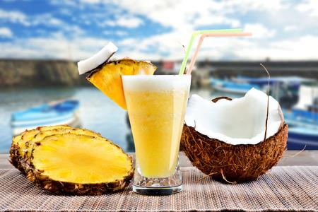 pina: Pinacolada pina colada cocktail with beach background Stock Photo