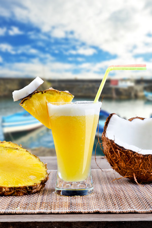 Pinacolada pina colada cocktail with beach background photo