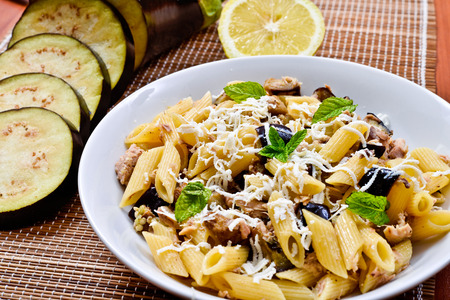 Pasta with eggplant, tuna, mint and ricotta salata. Recipe of Italian cuisine