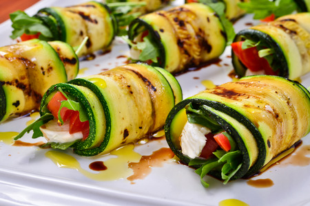 grilled zucchini with tomato, arugula and mozzarella cheese, drizzled with olive oil and balsamic vinegar