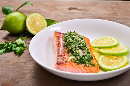 grilled salmon seasoned with lemon and parsley sauce
