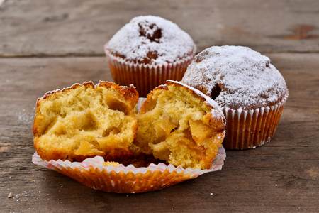 Closeup of an apple muffin on a rustic wooden board  Stock Photo